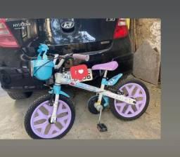 Título do anúncio: Bicicleta frozen  marca BANDEIRANTES com rodinha, praticamente nova !