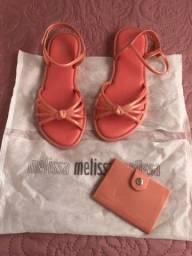 Melissa com carteira