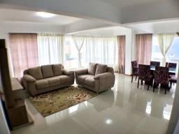 Apartamento de 2 dormitórios com 3 vagas de garagem a poucos metros de mar em Capão