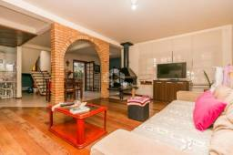 Casa à venda com 3 dormitórios em Auxiliadora, Porto alegre cod:9926595
