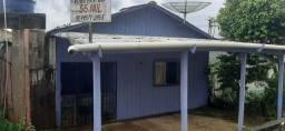 Casa de madeira macheada