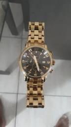 997146d8e04 Relógio technos dourado pouquíssimo uso