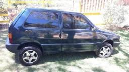 Carro fiat uno mille fire verde 2002 com ar. Duas portas - 2002