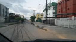 Terreno murado medindo 15 por 30 em Rua asfaltada todo registrado