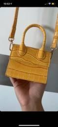 Título do anúncio: Bolsinha amarela NOVA