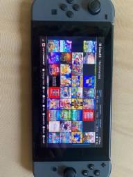 Título do anúncio: Nintendo switch desbloqueado completo na caixa