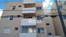 Apartamento com 2 dormitórios para alugar, 65 m² por R$ 1.200,00/mês - Santa Mônica - Uber