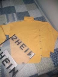 Malha tricô , tamanho M ,mas veste tbm G.Nova na embalagem .