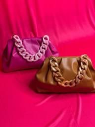 Bolsa feminina em material sintético nova