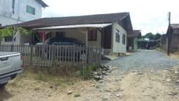 Vendo Terreno com 3 Casas de Madeira