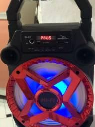 Caixinha de som bluetooth e lâmpada boate