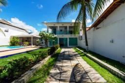 Casa duplex , condomínio à margem da praia, para venda tendo 190m²com   3 quartos