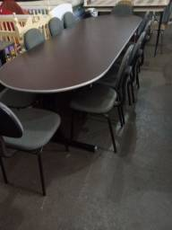 Mesa reunião com dez cadeiras