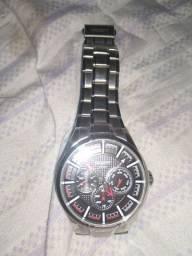 Relógio Orient 50 m com bordas dourada