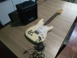 Guitarra com caixa distorção