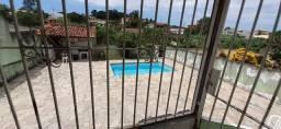 vendo casa com piscina no balneário pertinho da pista