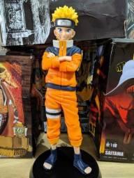 Figura de ação do Naruto com três cabeças