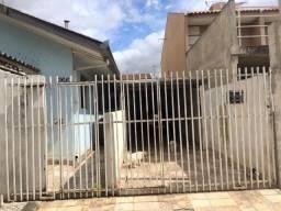 Vendo ou troco terreno com duas casas no bairro Campo de Santana