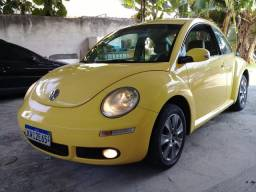 New beetle amarelo cambio manual simplesmente novo ac troca e cons financiamento