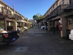 Título do anúncio: Casa em Condomínio para comprar no bairro Cavalhada - Porto Alegre com 3 quartos