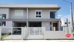 Casa com 3 dormitórios com 3 suítes à venda, 144 m² por R$ 845.000 - Ribeirão da Ilha - Fl