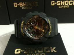 G-Shock GA-100 Preto Detalhes Dourados