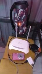 Caixa  + roteador + câmera digital
