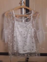 Vendo essa blusa no tamanho P veste também média valor 35$