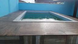 K- Casa com 2 quartos e completa com Área gourmet e piscina em Unamar!!