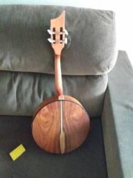 Troco banjo por guitarra
