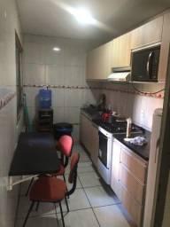 Apartamento quitado, com cozinha mobiliada