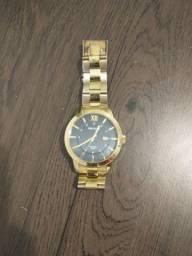 Relógio Seculus com botão da hora quebrado. $40