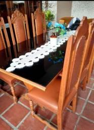 Requintada mesa de jantar colonial com seus cadeiras