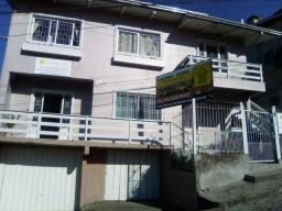 Alugo Casa Bairro Lourdes/Cruzeiro, com Fogão à Lenha, (próximo Joalheria Bonatto).