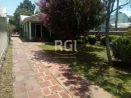 Casa à venda com 3 dormitórios em Guarujá, Porto alegre cod:MI270003