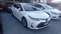 Título do anúncio: Corolla 2021<br>Altis 1.8<br>HIBRIDO <br>Autom<br>15000km<br>Revisão e garantia fábrica<br>Lindo igual zero