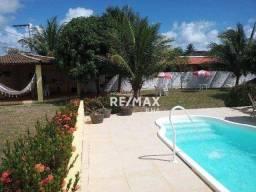 Título do anúncio: Casa com 4 dormitórios em condomínio fechado, 311 m² por R$ 530.000 - Aratuba - Vera Cruz/