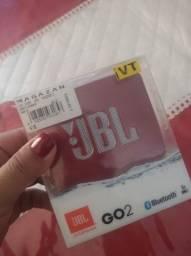 Vendo uma caixinha original da JBL vai cm todos os acessórios dela