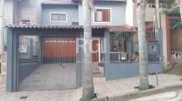 Casa à venda com 3 dormitórios em Guarujá, Porto alegre cod:MI269866