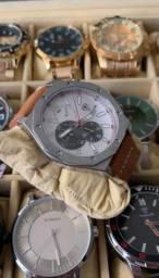 Relógio tuguir todo funcional com desconto pra hoje.