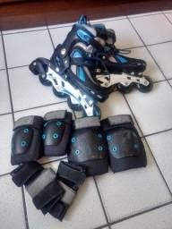 Vendo patins Oxer muito novo com equipamentos de proteção  !!!