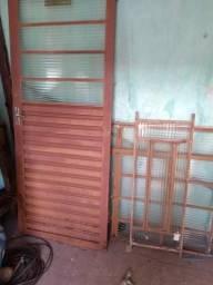 Uma porta com 2 janelas e uma churrasqueira 300 cada contato 018997552329