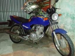Moto atrasada vendo como bruxinha - 2002