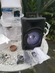 Caixa de Som Bluetooth, USB, Rádio FM, Controle Remoto, Microfone e Garantia