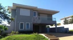 Casa de condomínio para alugar com 5 dormitórios cod:L14128