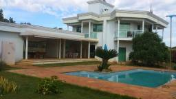 Casa com piscina e área gourmet em condomínio fechado em Lagoa Santa (CQ40)