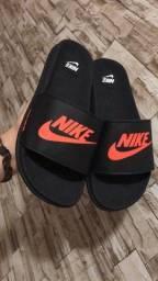 Chinelos Slides Nike Just Do It Preto com Laranja