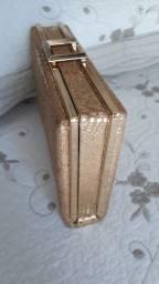 Bolsa de festa dourada