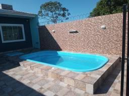 Casa praia de leste com piscina.