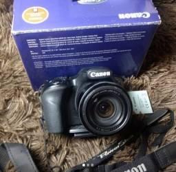 Câmera fotográfica semiprofissional Canon, acompanha mini tripé